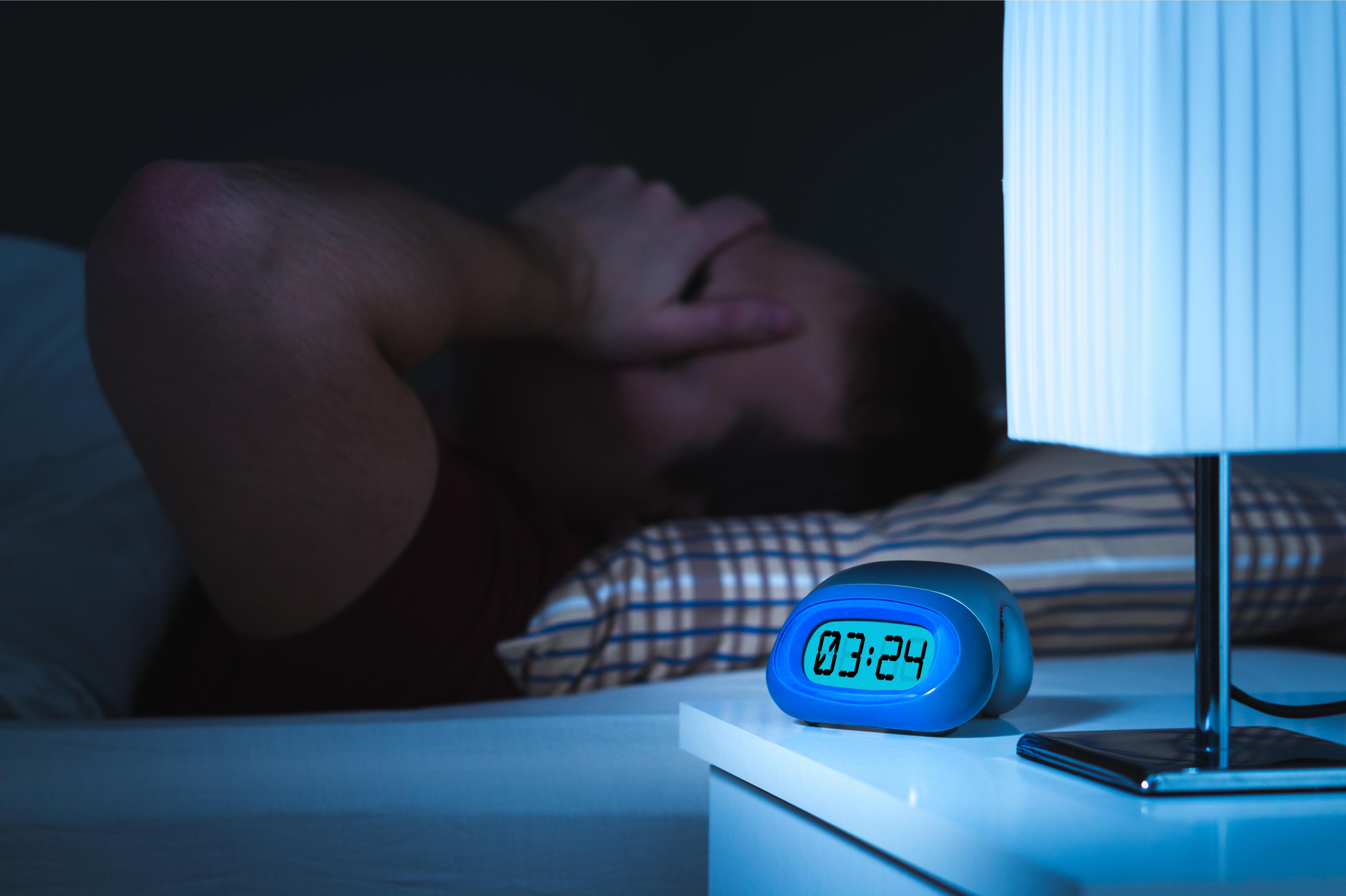 man-having-a-bad-nights-sleep
