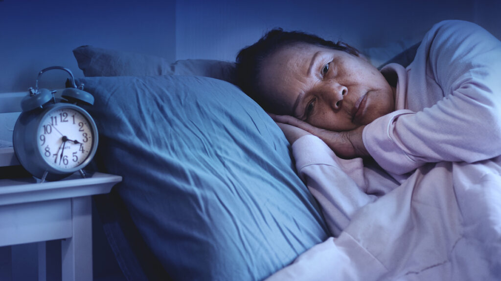 discount-mattresses-woman-insomnia